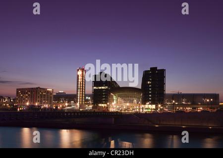 City skyline lit up at night - Stock Photo