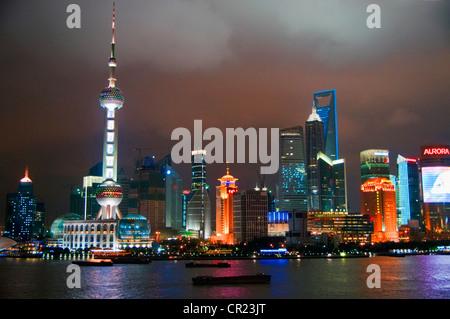 China: Shanghai's Pudong skyline at night - Stock Photo