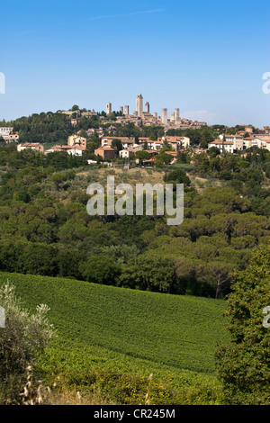 City on hillside in rural landscape - Stock Photo
