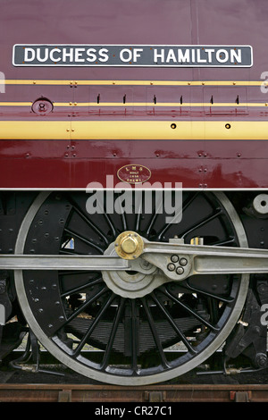 Nameplate and driving wheels of preserved LMS steam locomotive 6229 'Duchess of Hamilton'. - Stock Photo