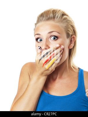 Worried football fan, female covering mouth with painted in flag colors hand, expressing fear and disappointment - Stock Photo