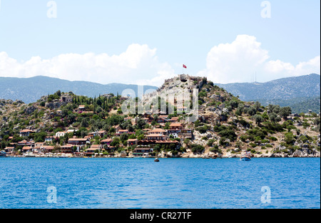 The village of Simena near Kekova. Ancient fortress on the top of the village. - Stock Photo