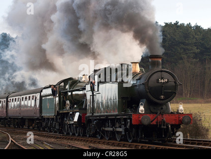 Double Header approaching Weybourne Station on the North Norfolk Railway in East Anglia, UK.  5619 and 4936 Kinlet - Stock Photo