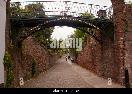 Wrought iron footbridge part of city wall in Exeter dates from 1814, 200 year old iron bridge. - Stock Photo