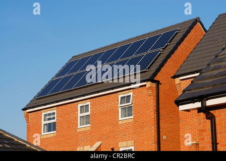 Modern house with solar power panels on the roof. - Stock Photo