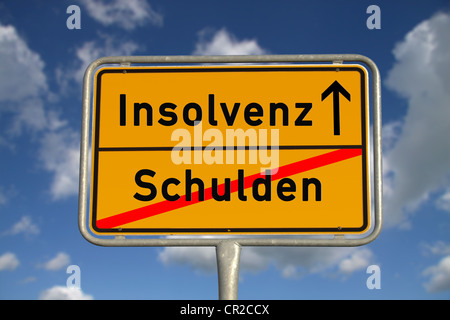 German road sign debt and bankruptcy with blue sky and white clouds - Stock Photo