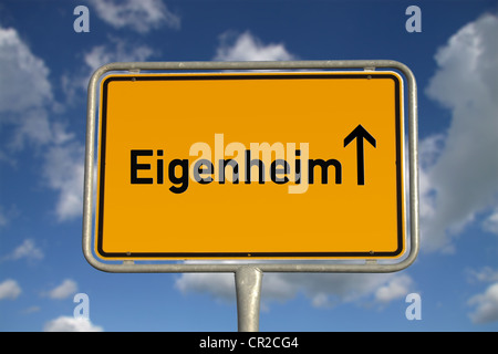 German road sign traffic owned home with blue sky and white clouds - Stock Photo