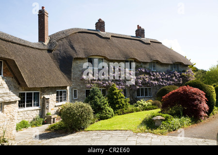 Beautiful stone built house / houses with thatch / thatched / thatching roof / roofs. Corfe Castle. Dorset UK. - Stock Photo