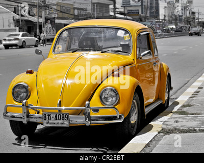 Vintage Yellow Volkswagen Beetle parked at the roadside. Thailand Asia - Stock Photo