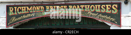 Traditional handpainted sign at boatbuilders shed, Richmond upon Thames, south west London - Stock Photo