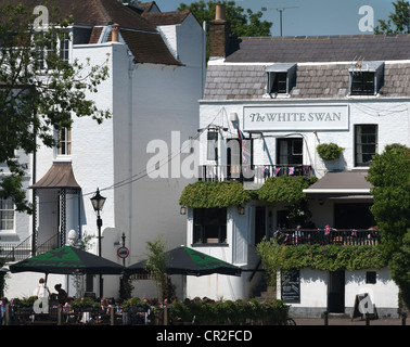 The White Swan pub on the banks of the River Thames at Twickenham in South West London, England, UK - Stock Photo