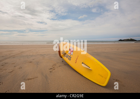 Lifeguards surfboard on beach in Cornwall - Stock Photo