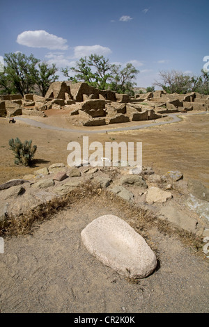 A corn grinding stone at Aztec Ruins National Monument, New Mexico - Stock Photo