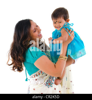 Happy Indian mother and daughter on white background - Stock Photo