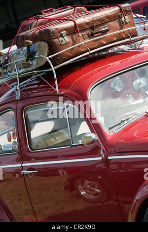 ... VW Volkswagen Beetle Car With Suitcases And Skateboard In The Roof Rack    Stock Photo