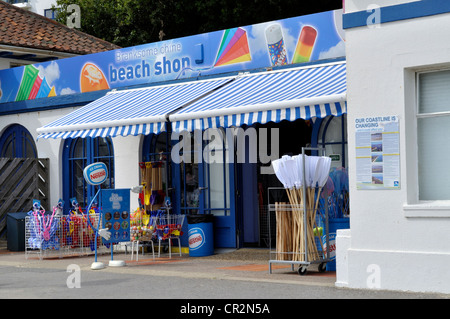 Beach shop at Branksome Chine beach, Poole, Dorset, on a windy and showery day in June. - Stock Photo