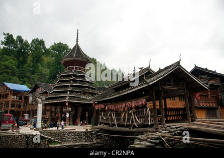 A small 'Wind and Rain' bridge and an ancient Drum Tower, Zhaoxing Dong Village, China - Stock Photo
