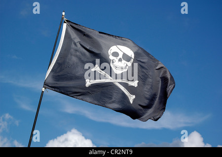 The ' Jolly Roger '  flying high - Stock Photo