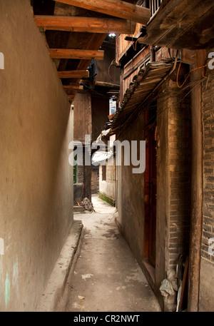 A narrow lane, Zhaoxing Dong Village, Southern China - Stock Photo