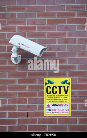 CCTV camera mounted on a building - Stock Photo