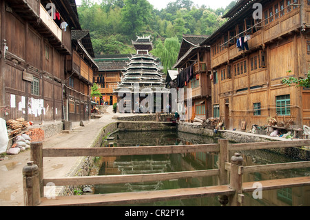 An ancient Drum Tower near an expanse of water, Zhaoxing Dong Village, Southern China - Stock Photo