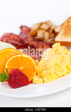 Delicious breakfast of scrambled eggs toast and bacon - Stock Photo