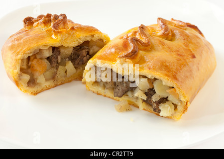 cornish pasty split in halves - Stock Photo