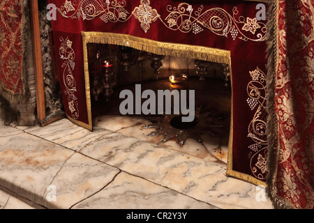 A silver star marks the traditional site of the birth of Jesus - Stock Photo