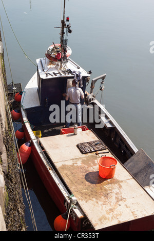 Man working on repair & maintenance. Fishing boat. Arbroath Harbour Scotland UK - Stock Photo