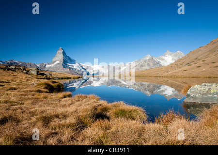 Mt Matterhorn reflected in Stellisee Lake, Zermatt, Canton Valais, Switzerland, Europe, PublicGround - Stock Photo