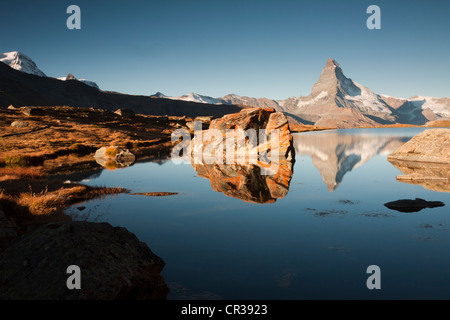 Mt Matterhorn, 4478 m, reflected in Stellisee Lake in the morning, from Stellisee Lake, Canton Valais, Switzerland, - Stock Photo