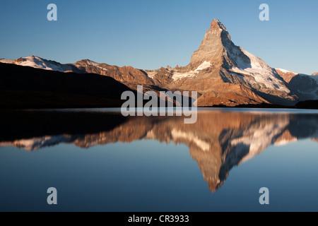 Mt Matterhorn is reflected in Mt Stellisee Lake in the morning, Zermatt, Canton Valais, Switzerland, Europe, PublicGround - Stock Photo