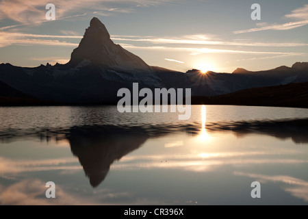 Sunset at Mt Matterhorn with reflections in Stellisee Lake, Zermatt, Canton Valais, Switzerland, Europe, PublicGround - Stock Photo