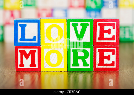 Love Spelled Out in Alphabet Building Blocks - Stock Photo