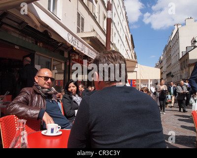 People enjoying cafe at a bistro on Rue Cler in Paris, France, May 13, 2012, © Katharine Andriotis - Stock Photo