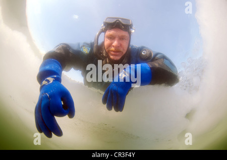 Diver's hand giving the OK sign, subglacial diving, ice diving, in the frozen Black Sea, a rare phenomenon - Stock Photo