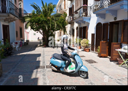 Italy Sicily Aeolian Islands listed as World Heritage by UNESCO Lipari Island Lipari scooter in a street of historical - Stock Photo