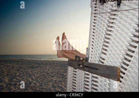Roofed wicker beach chair and bare feet, Westerland, Sylt, Schleswig-Holstein, Germany, Europe - Stock Photo