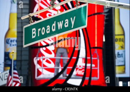 Broadway street sign and neon sign in Times Square, Manhattan, New York, USA, America - Stock Photo