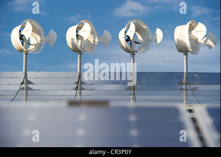 Small wind turbines and solar panels on a hotel roof, Freiburg im Breisgau, Baden-Wuerttemberg, Germany, Europe - Stock Photo