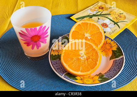 Cut orange on plate - Stock Photo