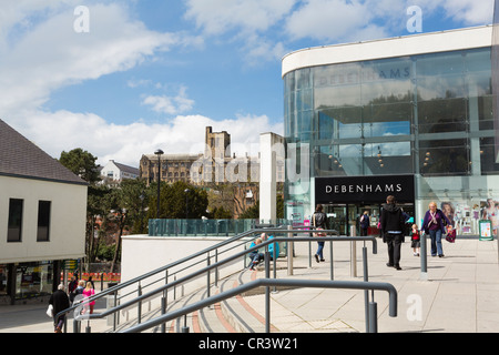 Modern Debenhams department store with shoppers outside and old university building beyond in city centre of Bangor, - Stock Photo