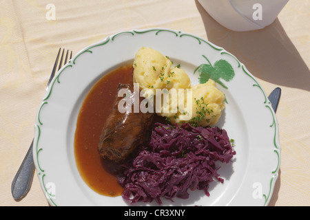 Beef roulade with mashed potatoes and red cabbage - Stock Photo