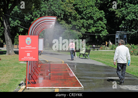 Public water sprinkling system, hot weather, water, cooling, summer, Bucharest, Romania, Eastern Europe, Europe, - Stock Photo