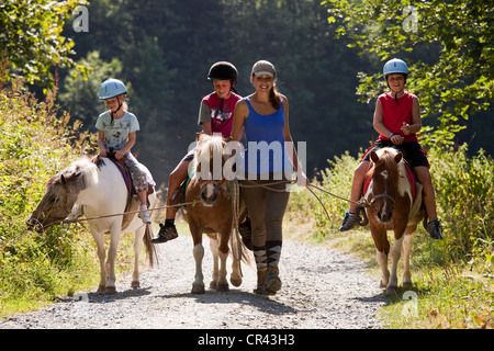 France, Savoie, Valmorel, pony ride at Plan Parc (1430 m) - Stock Photo