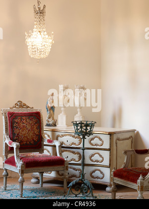 Antique chair with chest of drawers in Louis XVI style - Stock Photo