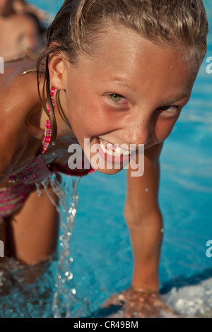 France, Corse du Sud, young girl at the swimming pool - Stock Photo
