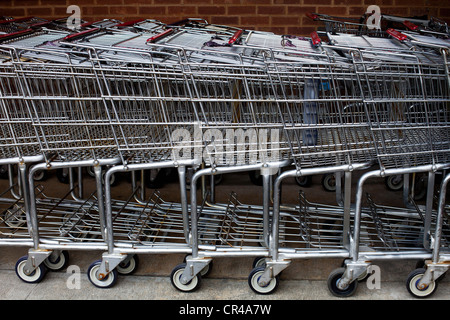Shopping Trolleys in a row outside a supermarket - Stock Photo