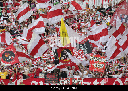 Red and white sea of flags in the stands of the  fans, VfB  football club, Mercedes-Benz Arena, , Baden-Wuerttemberg - Stock Photo