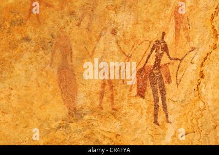 Painted warriors or hunters, neolithic rock art at Tin Meskis, Adrar n'Ahnet, Algeria, Sahara, North Africa - Stock Photo